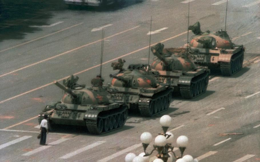 """A man stands alone to block a line of tanks heading east on Beijing's Cangan Blvd. in Tiananmen Square. on June 5, 1989.  Microsoft Corp. blamed """"accidental human error"""" for its Bing search engine briefly not showing image results for the search term """"tank man"""" on the anniversary of the bloody military crackdown in Beijing's Tiananmen Square in 1989."""