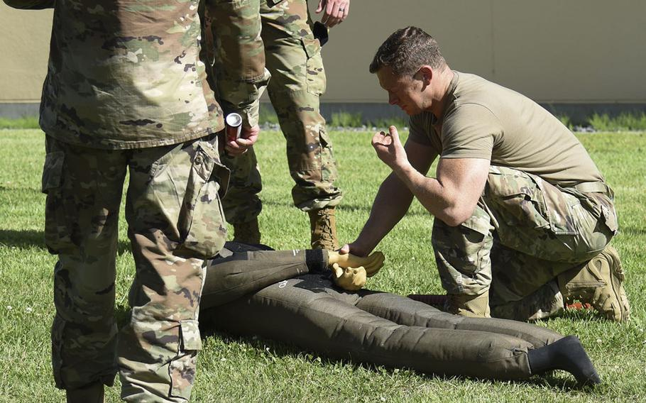 Maj. Matthew Stillman, commander of the 374th Security Forces Squadron, practices making an arrest after being pepper-sprayed during training at Yokota Air Base, Japan, July 21, 2021.