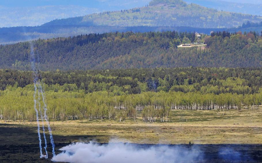 Seven nations coordinate mass artillery fire on May 19, 2021, at Grafenwoehr Training Area, Germany, during the Dynamic Front 21 exercise. The exercise includes approximately 1,800 participants from 15 nations in multiple locations.