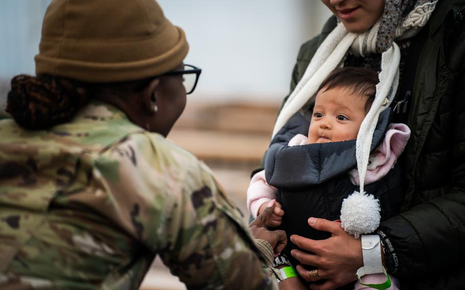 U.S Air Force Staff Sgt. Tessie Odhiambo, Personnel Support for Contingency Operations' noncommissioned officer in charge of personal support, helps evacuees prepare for a flight to the United States from Ramstein Air Base, Germany, Saturday, Oct. 9, 2021.