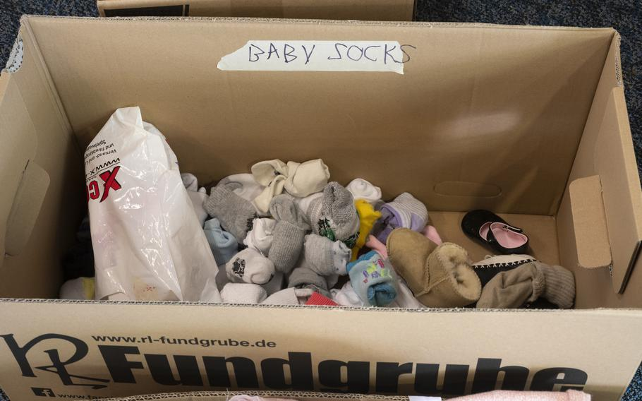 Donations for Afghan refugees are sorted by category at a supply drive at Ramstein Air Base on Aug. 26, 2021.