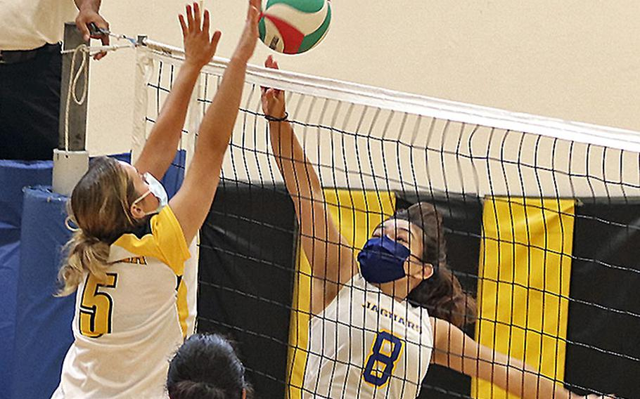 Marley Mcelree of Sigonella tries to get the ball over Vicenza's Shalom Dejardin during a September match at Vicenza. There is a full slate of girls volleyball action this weekend.