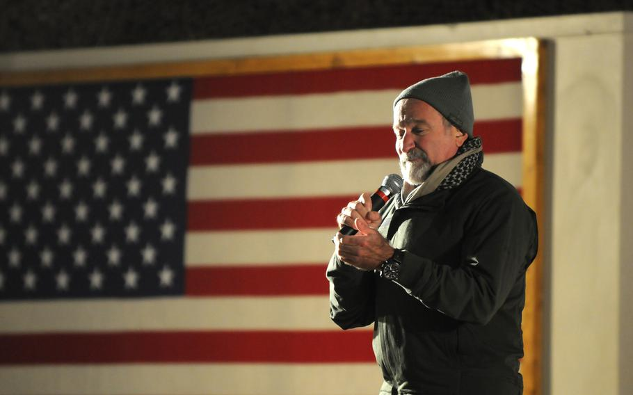 Actor and comedian Robin Williams performs his act for service members during the annual USO Holiday Tour on Bagram Airfield in December 2010.