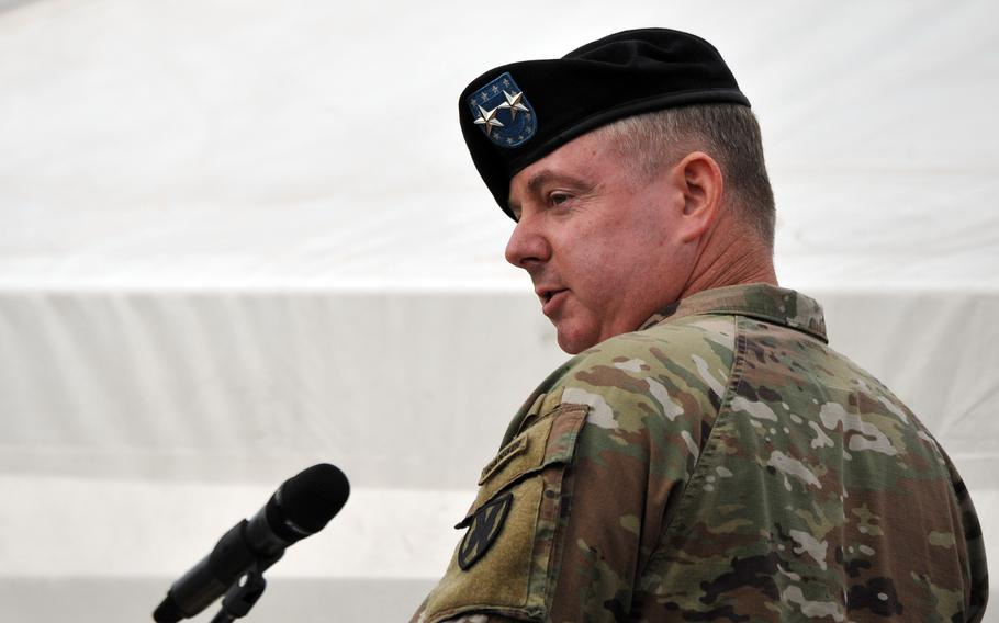 The outgoing commander of the 21st Theater Sustainment Command, Maj. Gen. Christopher Mohan, gives his farewell speech after turning over command to Brig. Gen. James Smith at Daenner Kaserne, Kaiserslautern, Germany, June 8, 2021.