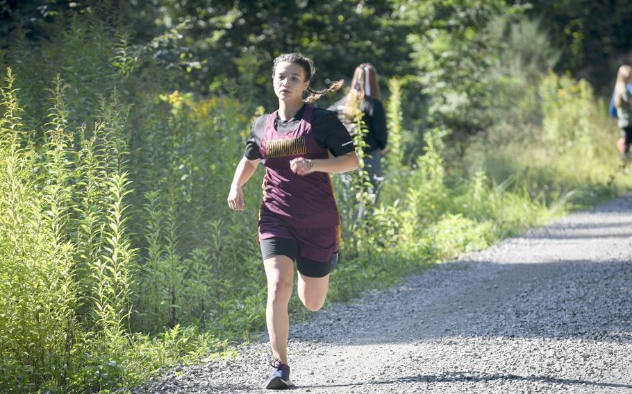 Kaleena Sais, a runner at Baumholder, charges down the final stretch of a high school girls' varsity cross country meet Saturday, Sept. 18, 2021, in Kaiserslautern, Germany.