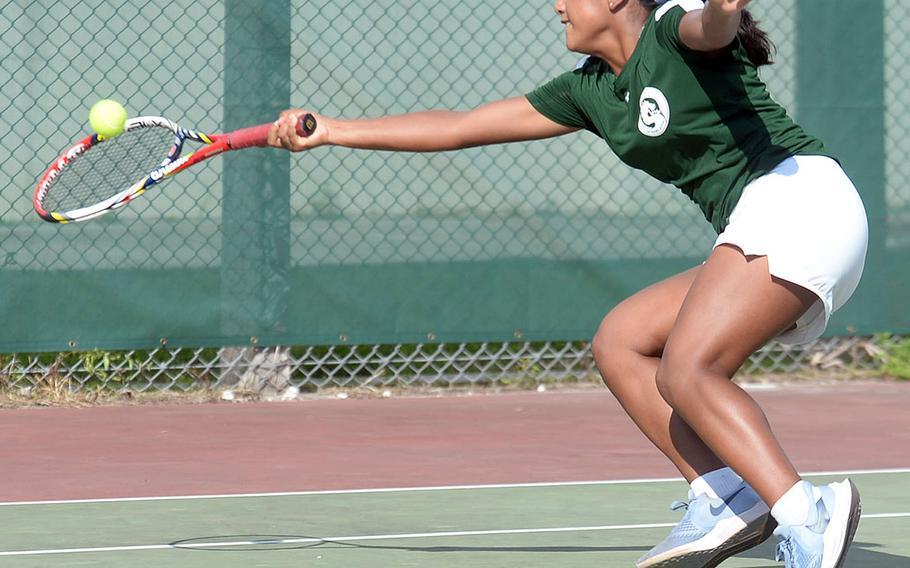 Kubasaki's Nicole Fuentes lunges for a forehand shot against Kadena's Elizabeth Cheramie during Wednesday's Okinawa tennis matches. Fuentes won 8-5.