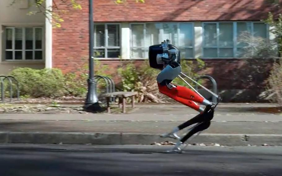 In a screenshot from a video on the Oregon State University YouTube site, Cassie, a bipedal robot developed by the university with funding from Defense Advanced Research Projects Agency, made history by learning how to run and then complete a 5-kilometer outdoor run.