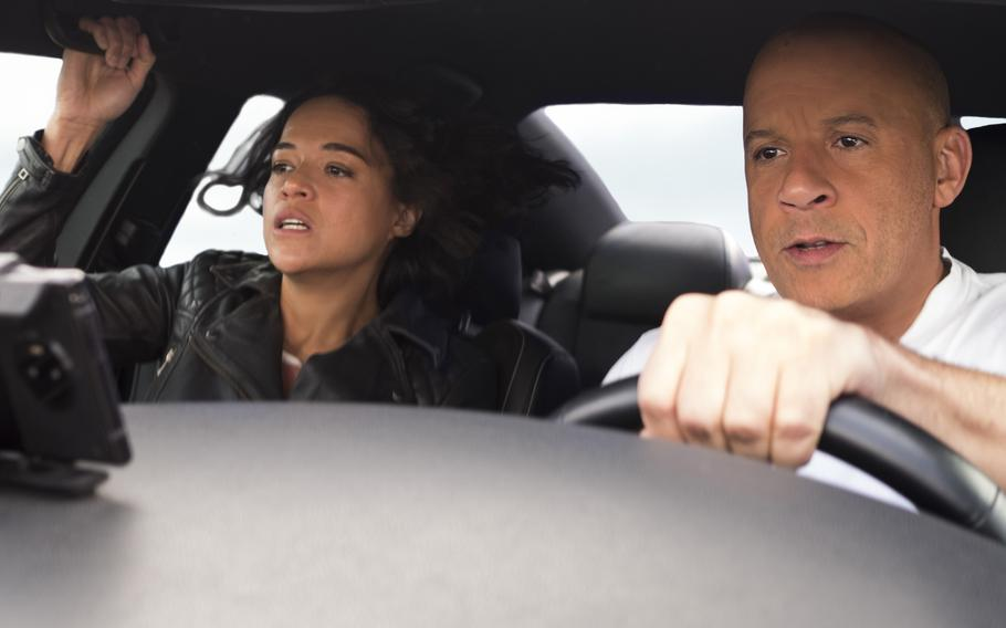 """Michelle Rodriguez, left, and Vin Diesel star in the latest """"Fast and Furious"""" movie, """"F9."""""""