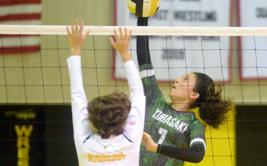 Kubasaki's Sophia Grubbs spikes against Kadena's Marina Sawyer during Thursday's Okinawa volleyball match. The Dragons won in straight sets, improving to 8-0 against the Panthers this season.