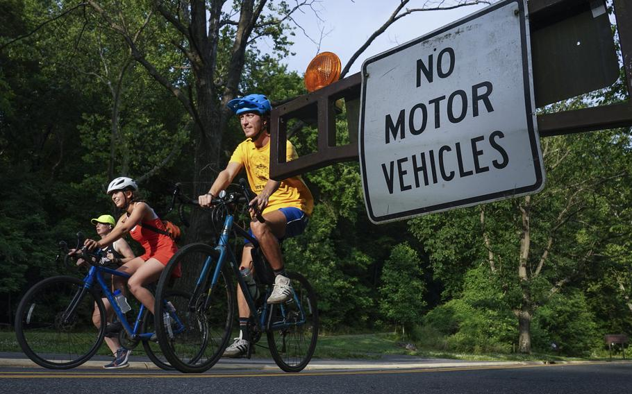 People enjoy a stretch of Beach Drive, which was closed to weekday car traffic, in Washington D.C.