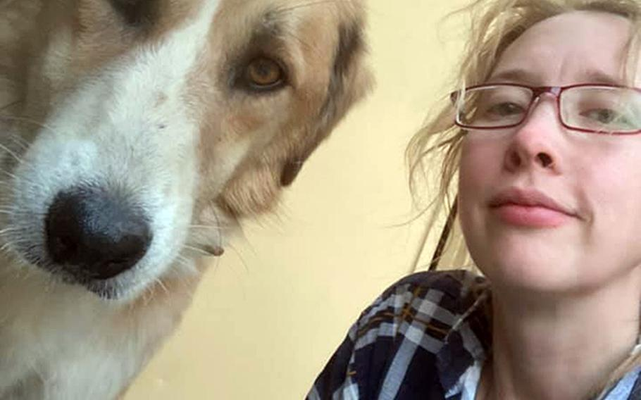 Charlotte Maxwell-Jones poses with a rescue dog at Kabul's airport on Aug. 29, 2021.