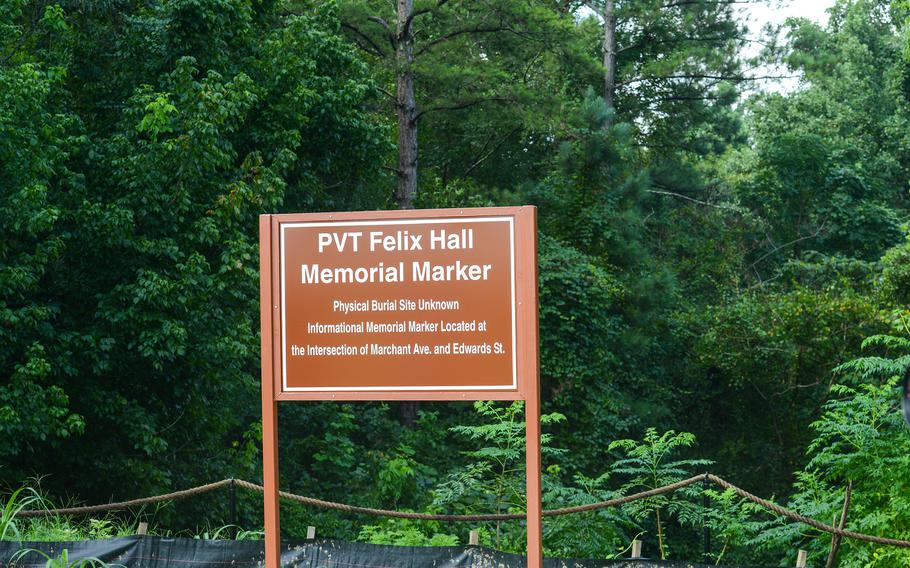 A temporary marker at Fort Benning, Ga. shows the approximate location Army Pvt. Felix Hall's body was found lynched about six weeks after he disappeared Feb. 12, 1941. Army officials plan to place a permanent, cement marker at the cite in the near future.
