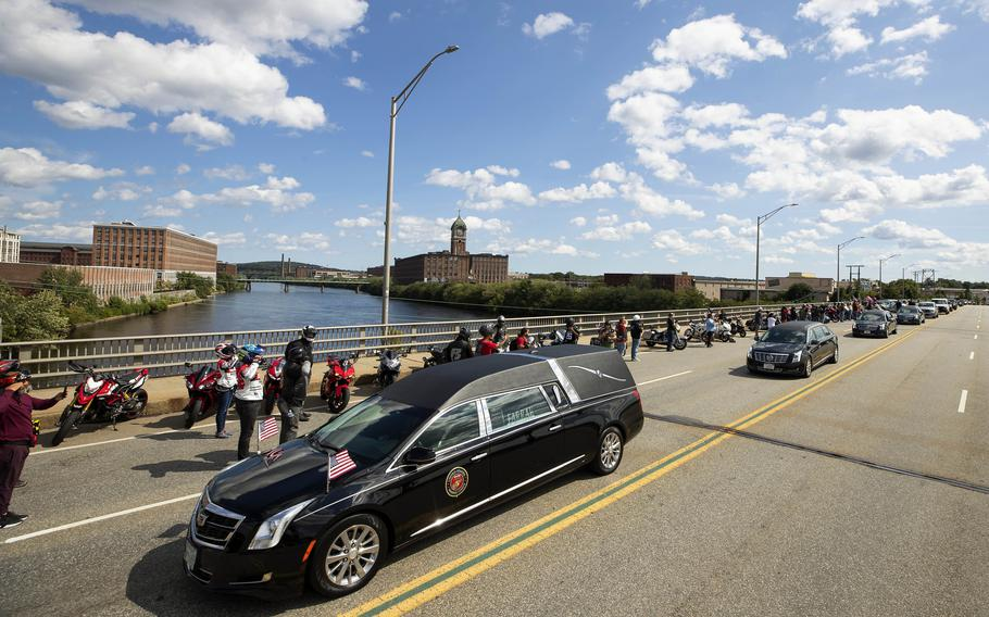 The hearse carrying the remains of US Marine Sgt.  Johanny Rosario Pichardo passes a line of bikers as she passes through his hometown of Lawrence, Massachusetts on Saturday, September 11, 2021.