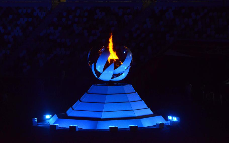 The Olympic flame burns inside the new National Stadium ahead of the Tokyo games' closing ceremony, Sunday, Aug. 8, 2021.
