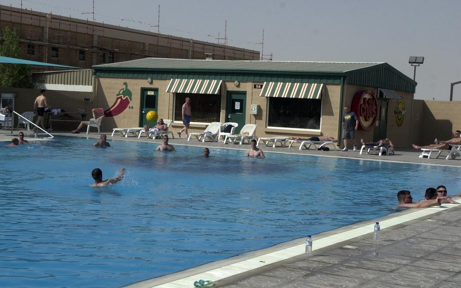 People swim in a pool at Camp As Sayliyah, Qatar, in 2004. The U.S. is planning to house Afghan interpreters and their families at the base, as they wait for asylum in the United States, according to The Wall Street Journal.