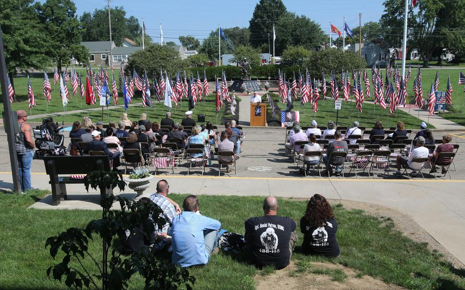 People gather for a 10th anniversary memorial service for Marines Sgt. Daniel Patron in Perry Township on Saturday, Aug. 21, 2021. Patron died Aug. 6, 2011, while defusing a roadside bomb while serving in Afghanistan.