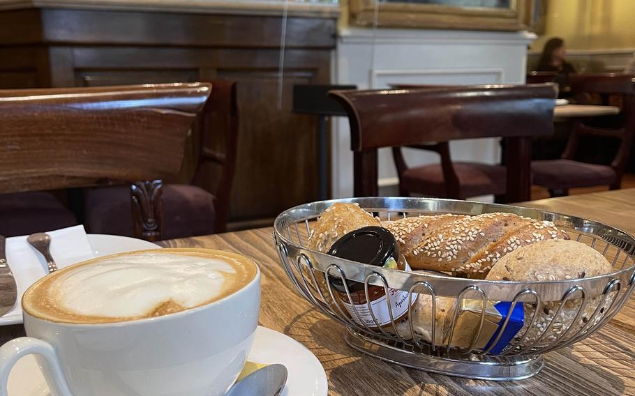 A cappuccino with bread rolls and some spreads at The Victorian House on July 2, 2021 in Munich, Germany.