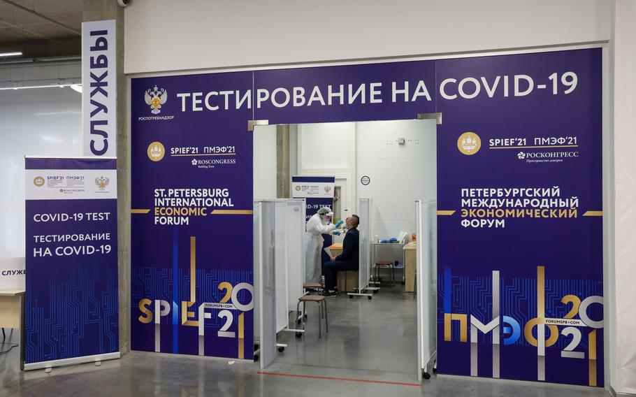 A medical worker administers a Covid-19 swab test to an attendee at a St. Petersburg International Economic Forum (SPIEF) testing point close to the airport in St. Petersburg, Russia, on June 2, 2021.