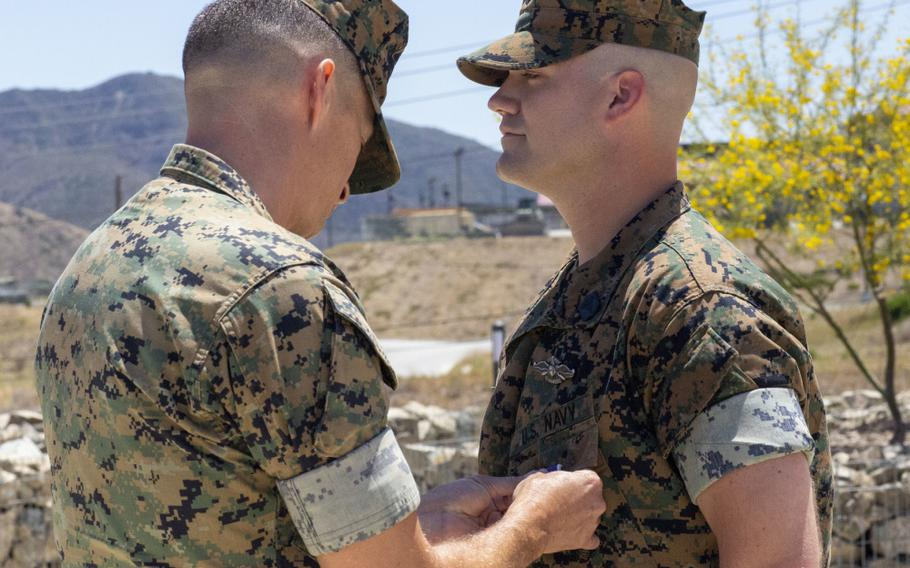 Lt. Col. Matthew T. Ritchie decorates Petty Officer 2nd Class Joseph Hardebeck with the Purple Heart Medal at Marine Corps Base Camp Pendleton, Calif., July 1, 2021. Hardebeck was awarded the Purple Heart for injuries sustained in support of Operation Enduring Freedom.