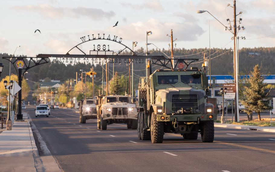 Marines drive down a street in Williams, Ariz., May 15, 2021.  Marines with 2nd Transportation Battalion, Combat Logistics Regiment 2, 2nd Marine Logistics Group crossed the United States in one of the longest convoys in the service's history.