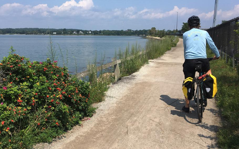 The author gets ready to push off his bike as he heads toward downtown Portland, Maine, from the Back Cove Trail.