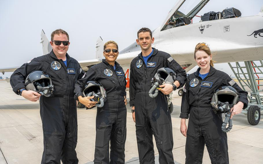 """In this Aug. 8, 2021, photo provided by John Kraus, from left, Chris Sembroski, Sian Proctor, Jared Isaacman and Hayley Arceneaux stand for a photo in Bozeman, Mont., during a """"fighter jet training"""" weekend to familiarize the crew with G-forces."""
