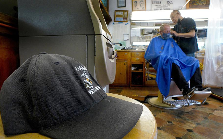 Johnny Gomez, 84, cuts the hair of Richard Mathys, a retired Marine, on Wednesday, Aug. 18, 2021 at Esquire Barber Shop in Oceanside, Calif.