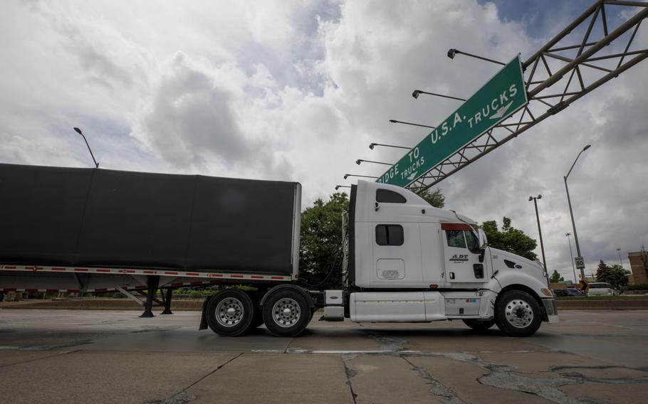 A truck enters a queue to cross the Ambassador Bridge into Detroit, Michigan, from Windsor, Ontario, on May 26, 2021.
