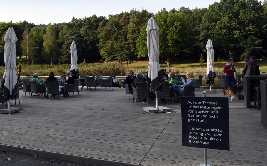 Some of the outdoor seating at the Seewooghutte in Ramstein-Miesenbach, Germany, overlooks the water. The kiosk reopened with expanded seating and a bigger menu last year. A playground was also built near the new kiosk.