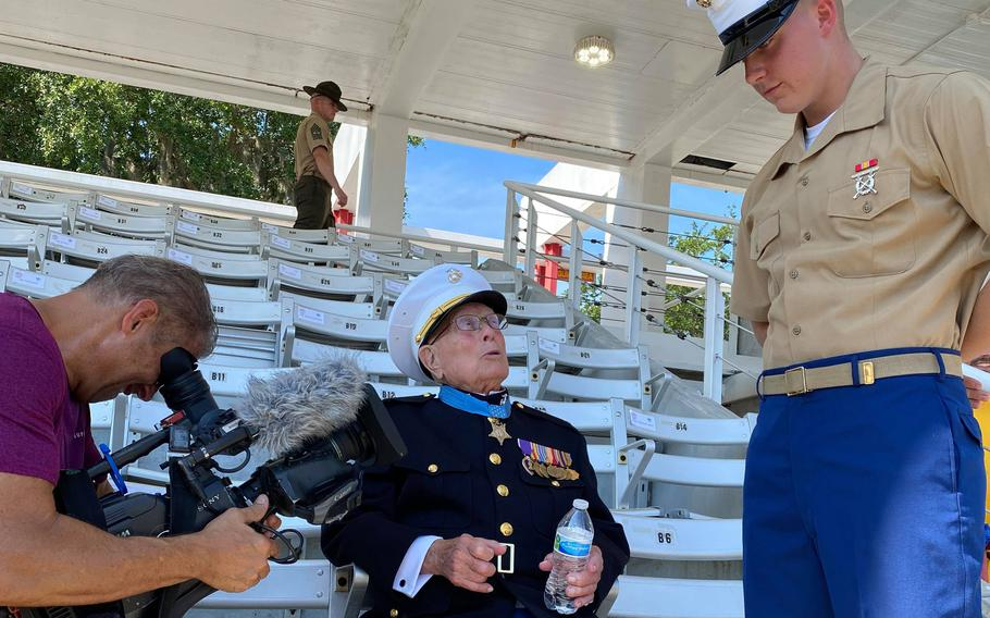 """Retired Marine Hershel """"Woody"""" Williams, left, speaks with his great-grandson Pfc. Cedar Ross, left, at Parris Island, S.C., where Ross graduated from Marine boot camp Friday, June 18, 2021. Williams, 97, is a veteran of the Battle of Iwo Jima, and the last living recipient of the Medal of Honor from World War II."""