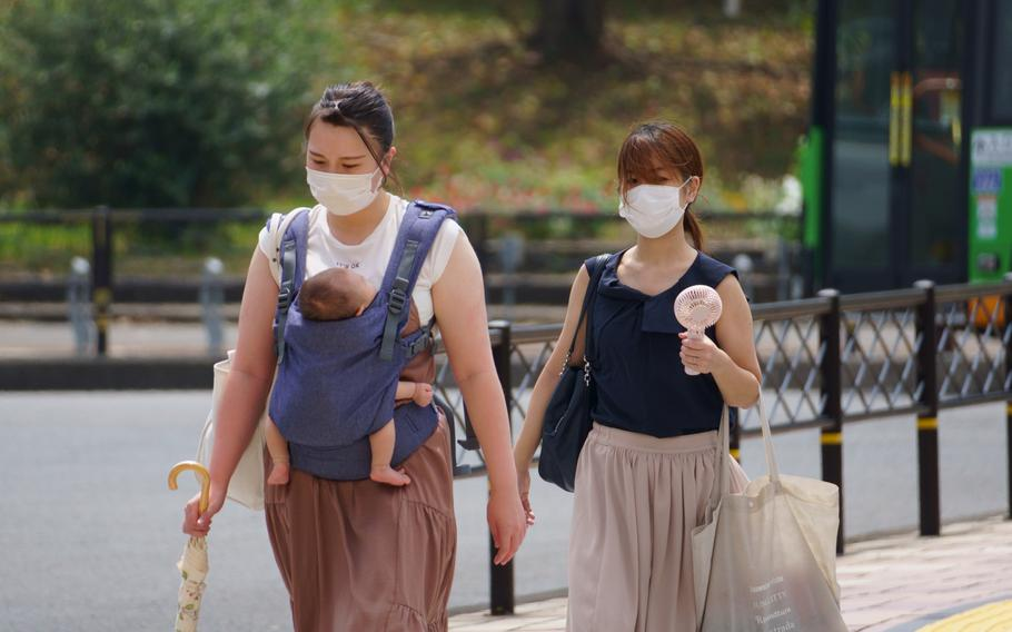 Women in central Tokyo wear masks to help stem the spread of coronavirus on Aug. 27, 2021.