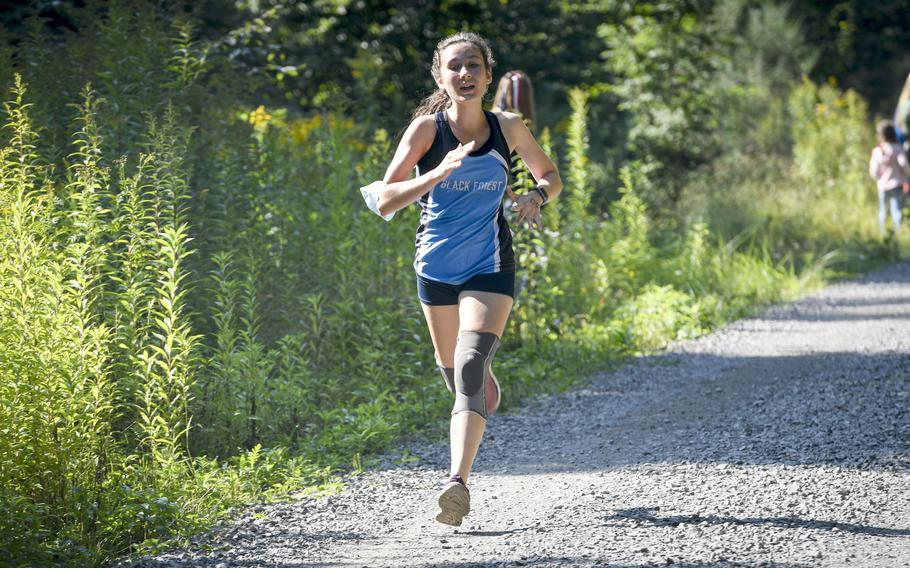 Naomi Boyd, a runner at Black Forest Academy, dashes down the final stretch of a high school girls' varsity cross country meet Saturday, Sept. 18, 2021, in Kaiserslautern, Germany.