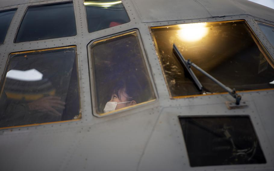 A Japanese elementary school student tours a KC-130J Super Hercules during a visit to Marine Corps Air Station Iwakuni, Japan, Thursday, Sept. 23, 2021.