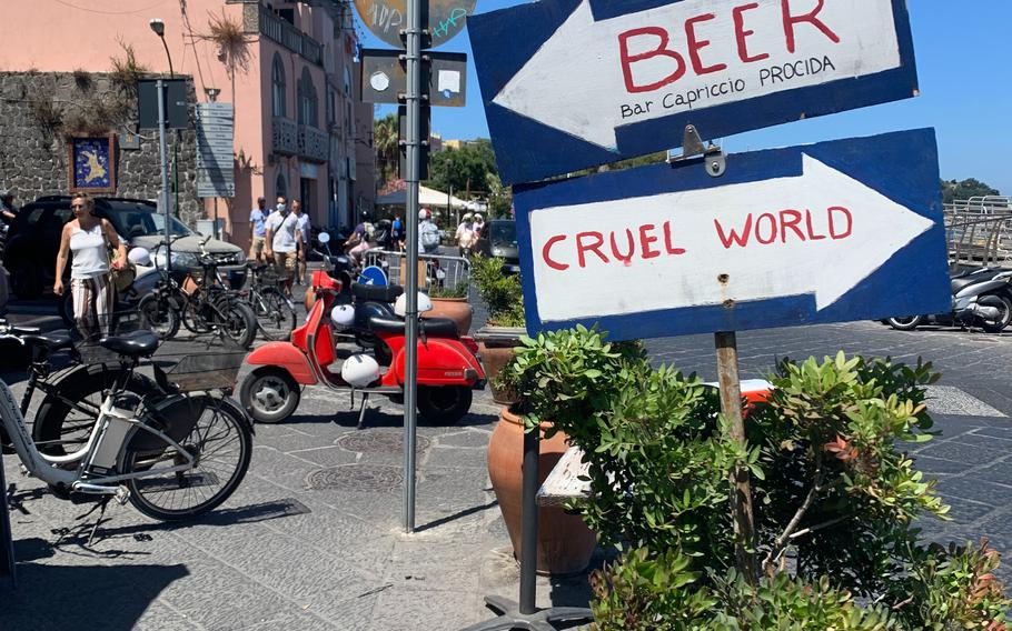 The waterfront near where ferries drop off visitors to Procida is filled with cafes and bars, including some with humorous signs to attract customers.