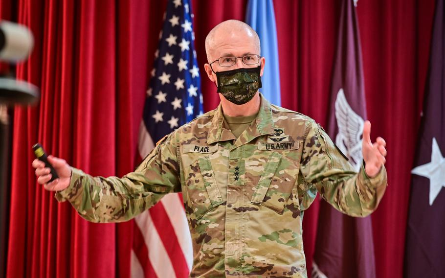 Lt. Gen. Ronald Place, director of the Defense Health Agency, speaks at a town hall meeting with staff and virtually Feb. 23, 2021, at Tripler Army Medical Center, Hawaii.