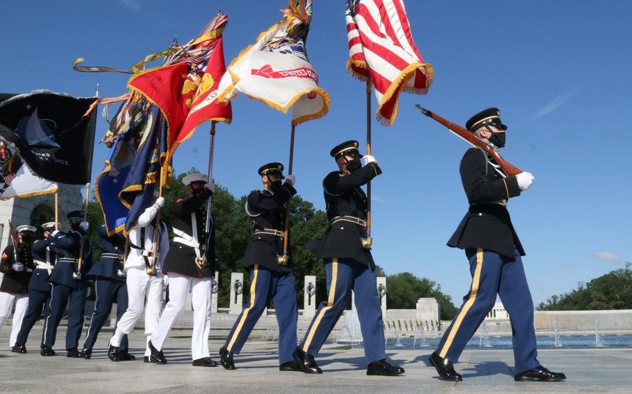 The color guard arrives for a Memorial Day ceremony at the National World War II Memorial in Washington, D.C., May 31, 2021.