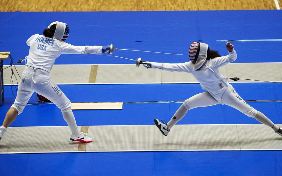 Katharine Holmes, left, an epee fencer for the U.S. women's Olympic team, spars with junior athlete Lola Constantino inside Lotus Culture Center Arena at the Atago Sports Complex in Iwakuni, Japan, July 16, 2021.