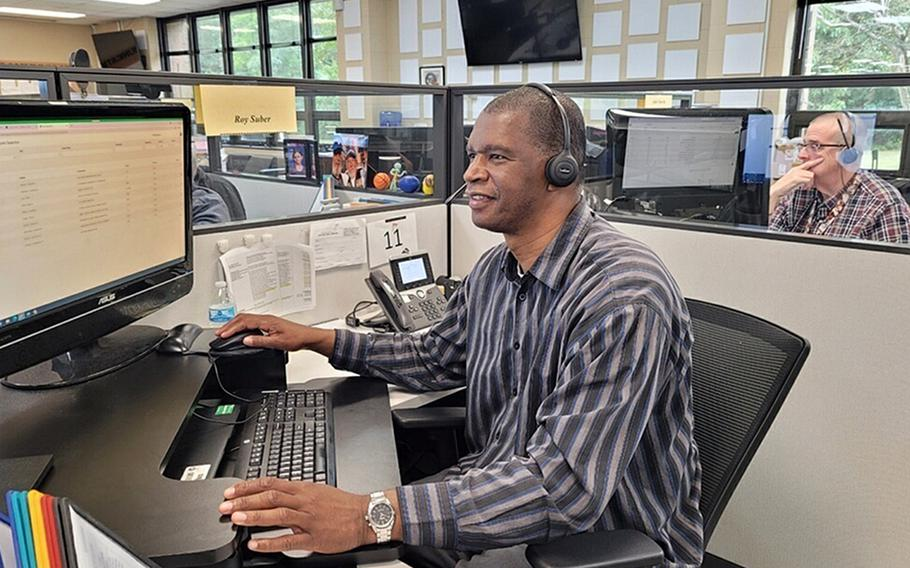 Roy Suber, an education counselor with the Navy College Virtual Education Center in Virginia Beach, Va., assists a sailor over the phone on Sept. 23, 2021.