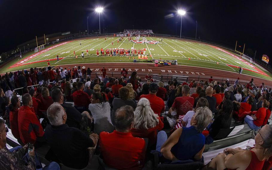 Fans fill the stadium at the football field at Whitewater High School on Friday, Oct. 1, 2021, in Whitewater, Wis. A growing number of school districts in the U.S. are using federal pandemic funding on athletics projects. When school officials at Whitewater learned they would be getting $2 million in pandemic relief this year, they decided to set most of it aside to cover costs from their current budget, freeing up $1.6 million in local funding that's being used to build new synthetic turf fields for football, baseball and softball.