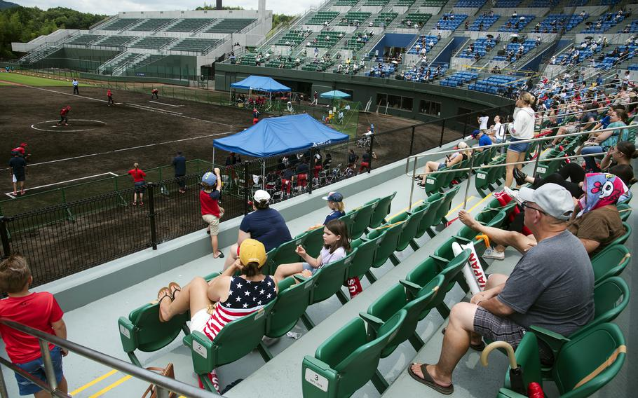 People watch the U.S. Women's Olympic softball team's exhibition game against the Toyota Red Terriers in Iwakuni, Japan, Monday, July 12, 2021.