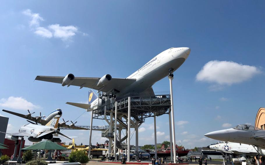 A Lufthansa 747 jumbo jet towers over a Vickers Viscount airliner and assorted warplanes at the Technik Museum Speyer in Germany. A staircase leads up to both airliners, but its not an easy climb.