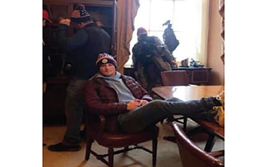 Andrew Ericson is seen inside the U.S. Capitol with his feet propped up on a table during the Jan. 6, 2021, riot.