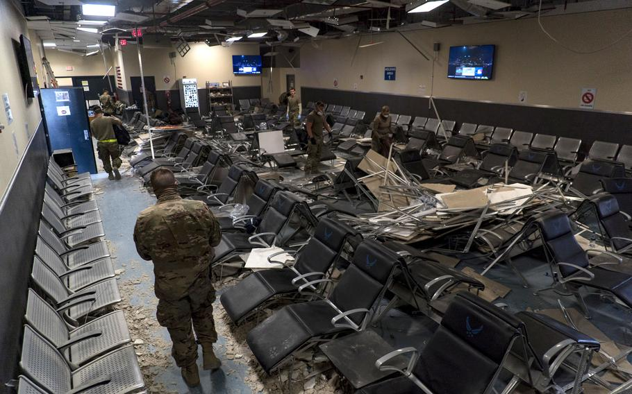 U.S. Air Force airmen from the 405th Expeditionary Support Squadron work to clear debris inside the passenger terminal at Bagram Airfield, Afghanistan, following a Taliban-led attack, Dec. 12, 2019.