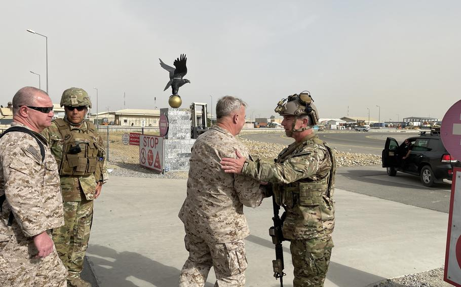U.S. Marine Corps Gen. Frank McKenzie, the commander of U.S. Central Command, meets with U.S. Navy Rear Adm. Peter Vasely, commander of U.S. Forces Afghanistan-Forward, at Hamid Karzai International Airport, Afghanistan on Aug. 17, 2021.