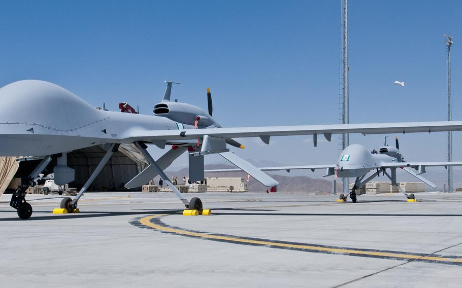 Two freshly assembled Grey Eagle unmanned aerial vehicles sit on the tarmac at Forward Operating Base Shank in Logar Province, Afghanistan, in 2012.