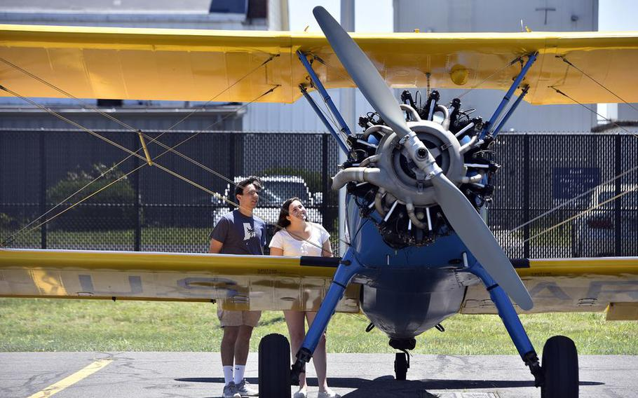 Andrew Estus and Cailin Fairbrother of South Kingston, R.I., check out a 1940s-era Stearman training plane.
