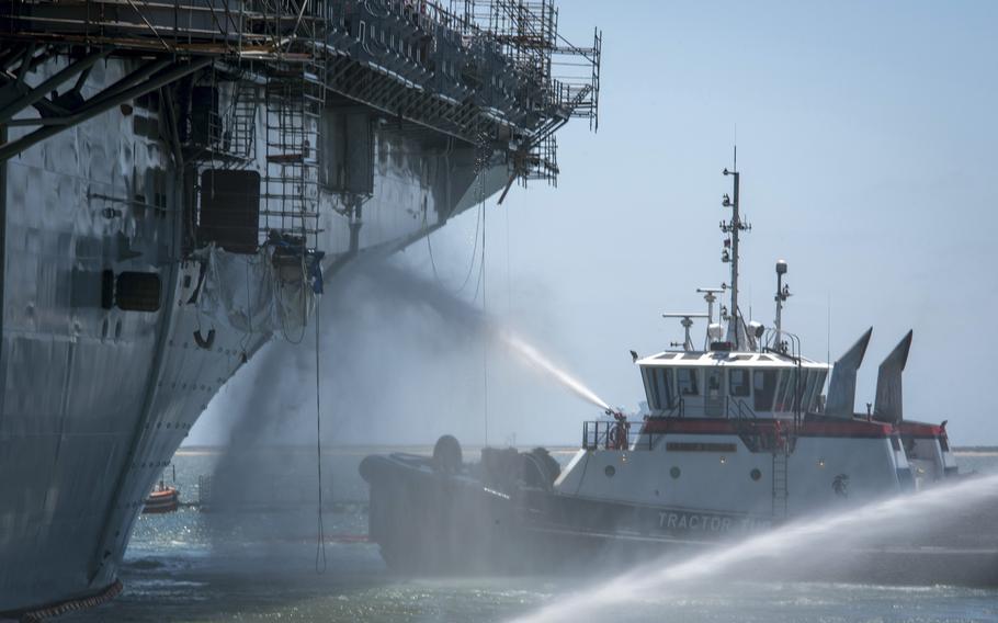 Firefighters combat a blaze aboard the USS Bonhomme Richard at Naval Base San Diego, July 14, 2020.