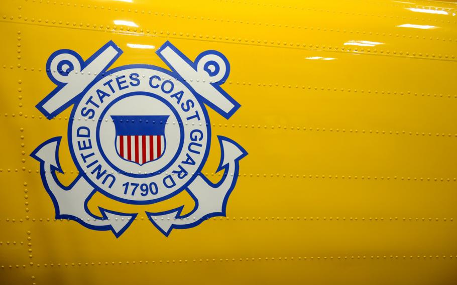 Logo on the chrome yellow port side tail section of a MH-60 Jayhawk helicopter.