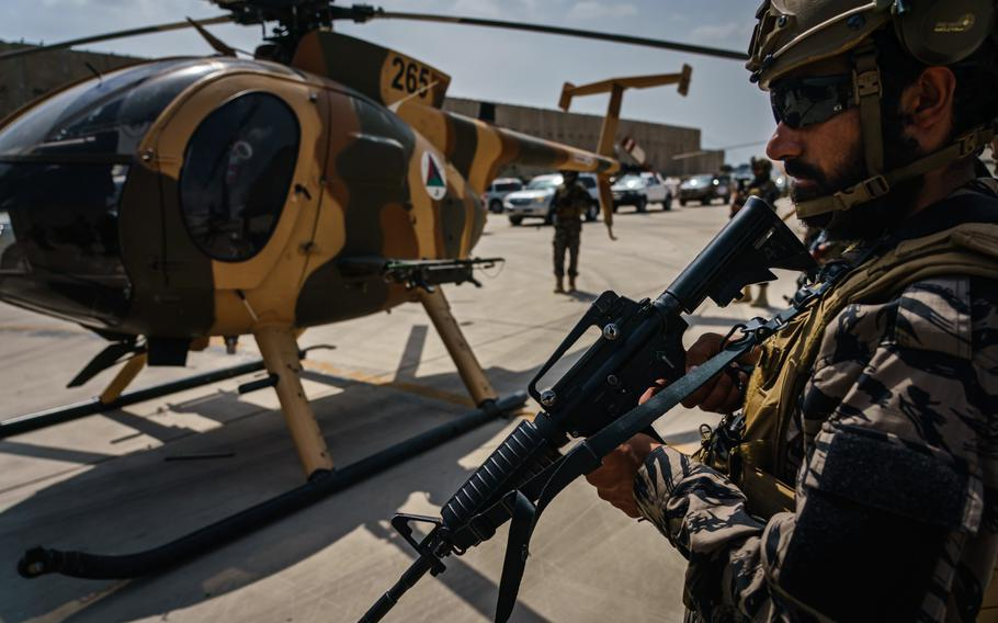 Taliban fighters stand ready as the militant group secure the Hamid Karzai International Airport, in the wake of the American forces completing their withdrawal from the country in Kabul, Afghanistan, Tuesday, Aug. 31, 2021.
