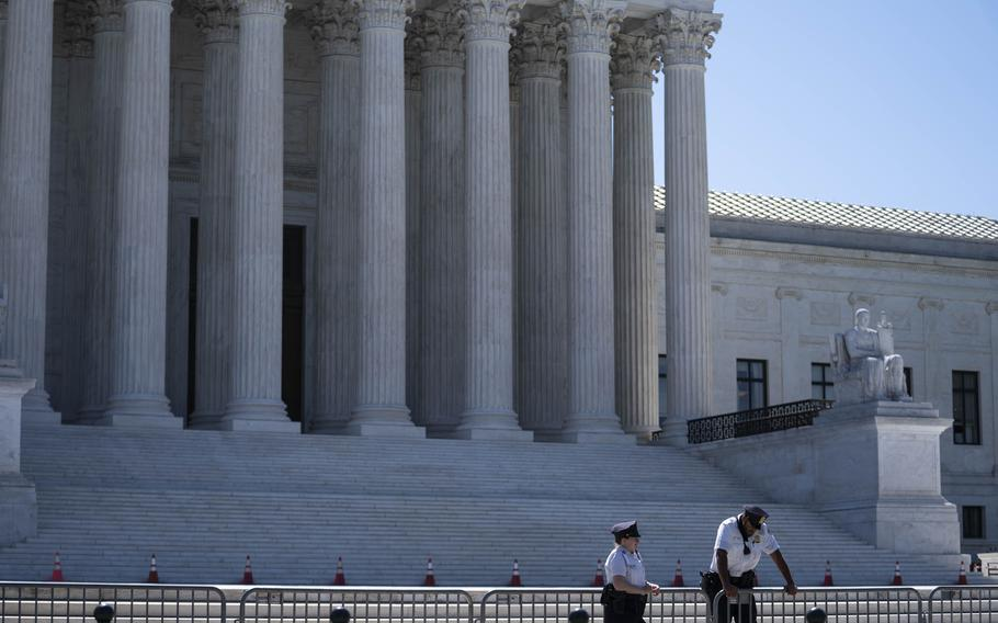 U.S. Supreme Court police officers stand outside in Washington, D.C., on June 17, 2021.